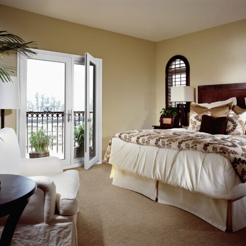 Traditional Style Bedroom with Doors to Balcony